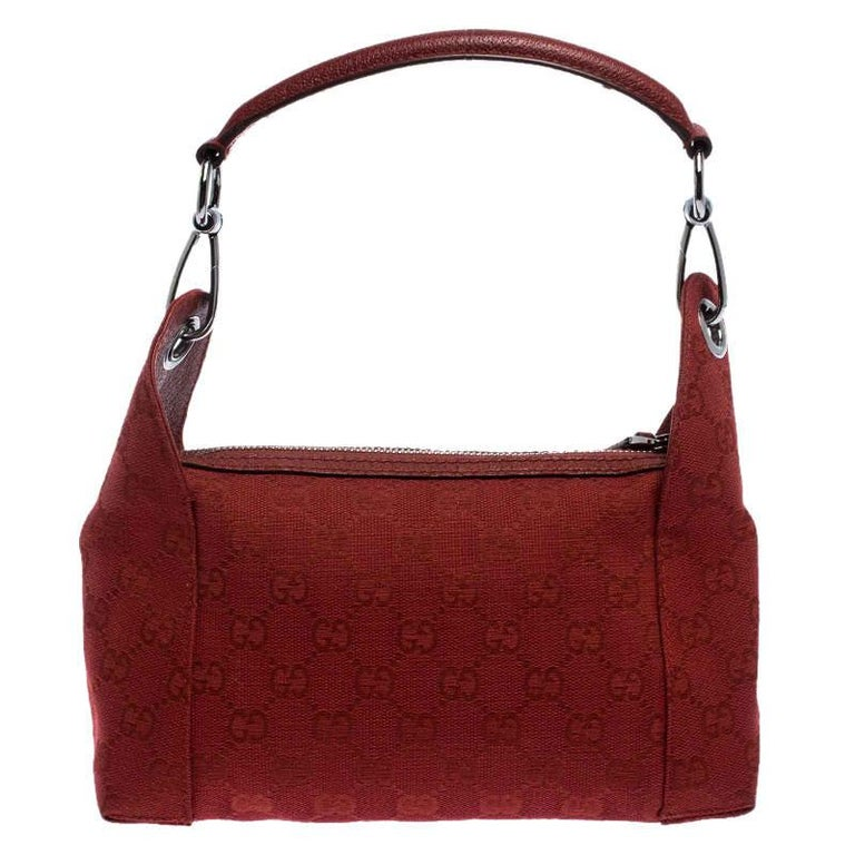 Get this stunning bag by Gucci now. Crafted from the brand's signature GG canvas and leather it comes in a striking shade of red. It is held by a single shoulder strap, has a top-zip closure that opens to a fabric-lined interior with a zip pocket
