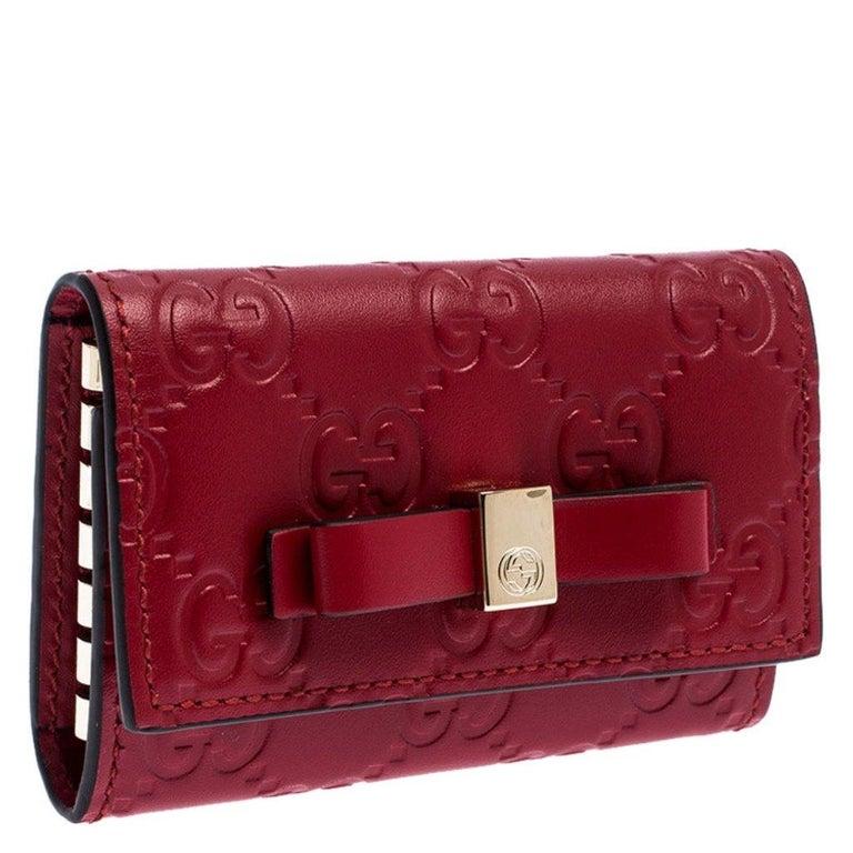 Gucci Red Guccissima Leather Bow 6 Key Holder In New Condition For Sale In Dubai, Al Qouz 2
