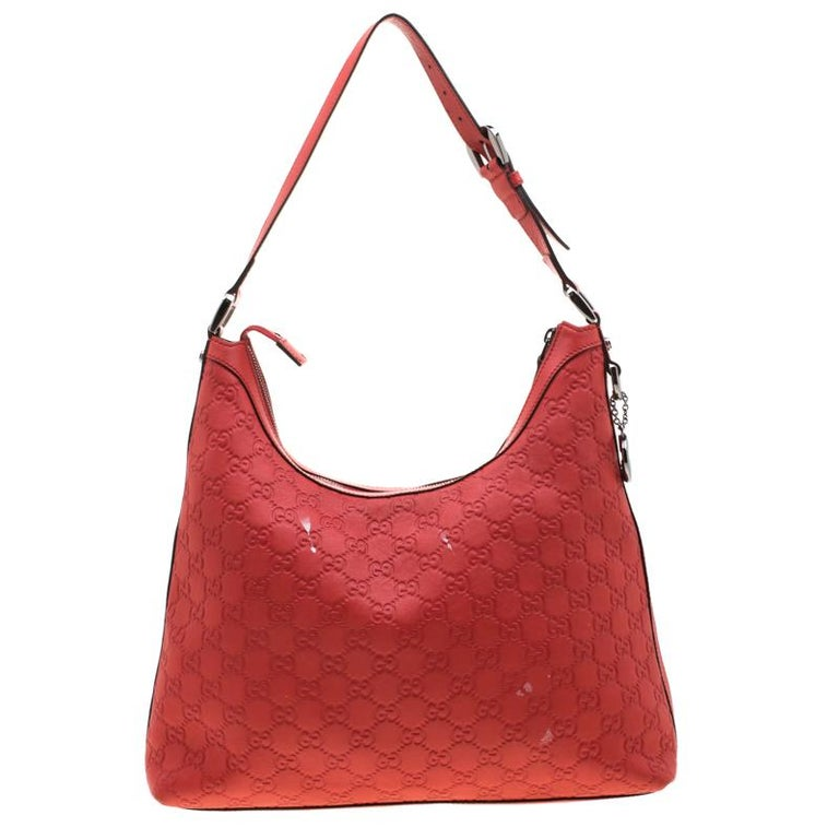 Masterfully crafted with Guccissima leather, this bag is a prize to own. Lined with the finest fabric, the interior of this bag has enough space for more than just your essentials. A single handle and a GG charm complete this hobo.  Includes: The