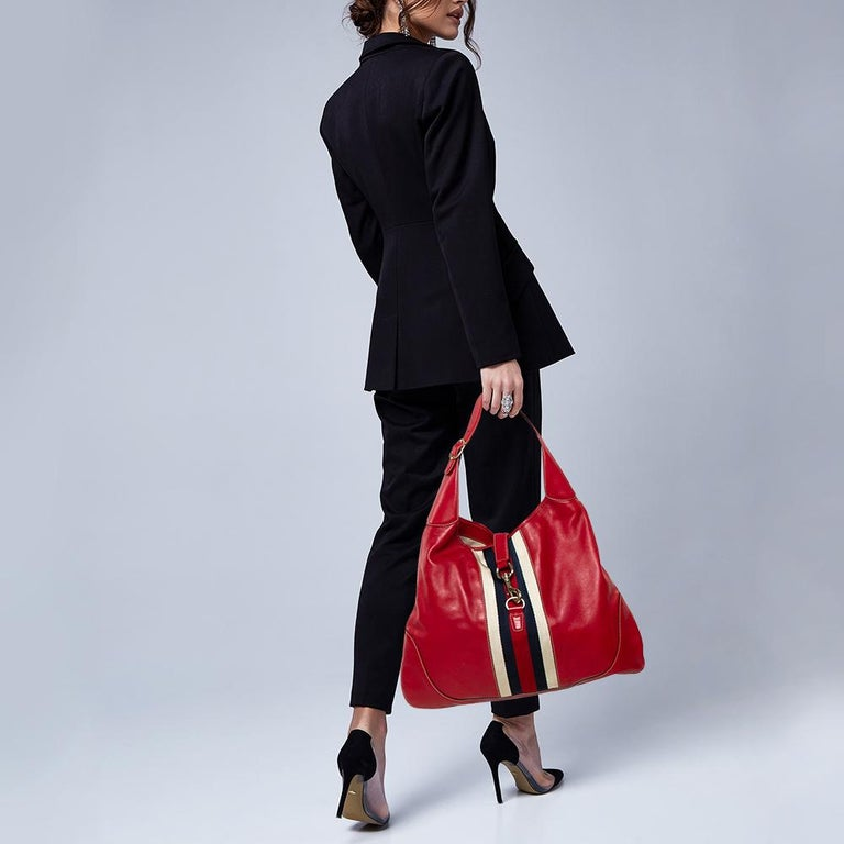 Gucci has always offered a bevy of cult-favorite bags, just like this Jackie O' Bouvier hobo created as a homage to Jacqueline Kennedy Onassis. It is crafted from canvas and leather in a red shade and flaunts the Web stripe on the front. A piston