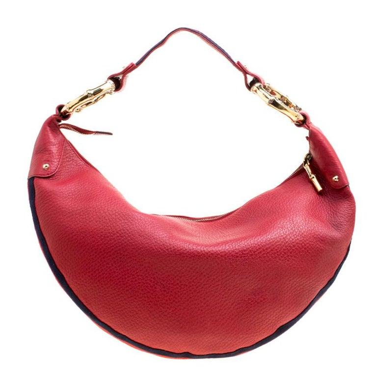 Hobos are all the rage with fashionistas at the moment, especially if designed by Gucci. This pretty red hobo is crafted out of pebbled leather with web-detailed trims on the outline and features a bamboo ring single, signature web strap. With a