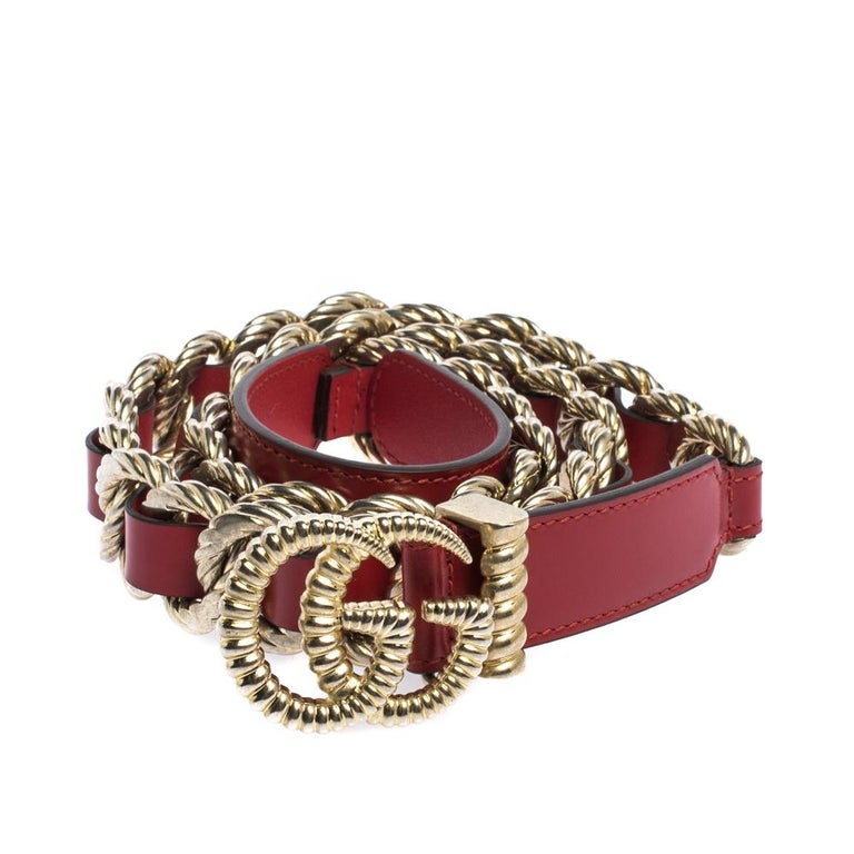 This Gucci belt will add a perfect touch of style and glamour to your outfits. Crafted from beautiful striking red leather that is complemented with a gold-tone chain and interlocking GG buckle, this belt is an epitome of style. Style it with a