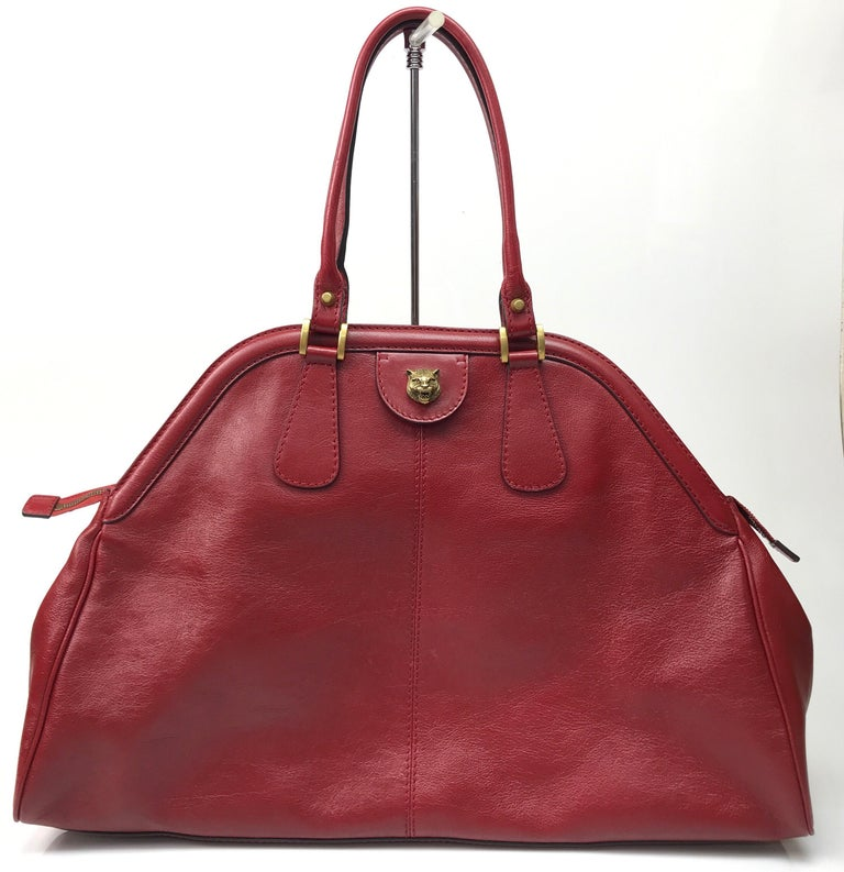 Gucci Red Marmont Re(Belle) Handbag. This beautiful Gucci handbag is in excellent condition. It has no sign of use and has the care card with a color swatch in the pocket. It is a large bag with a deep red leather material. There is gold hardware