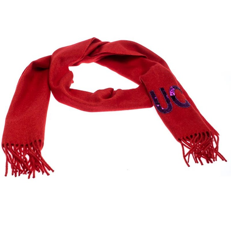 Beautifully cut from silk and cashmere, this Gucci scarf features a sequin GUCCI logo on the bright red background. It is finished with fringed edges. Make this gorgeous scarf yours today, and flaunt it like a fashionista!  Includes: The Luxury