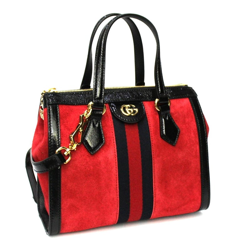 Gucci Ophidia model bag made of red suede with black leather details with golden hardware.  Equipped with handles and removable shoulder strap. Zip closure, internally quite large.  Like new condition.