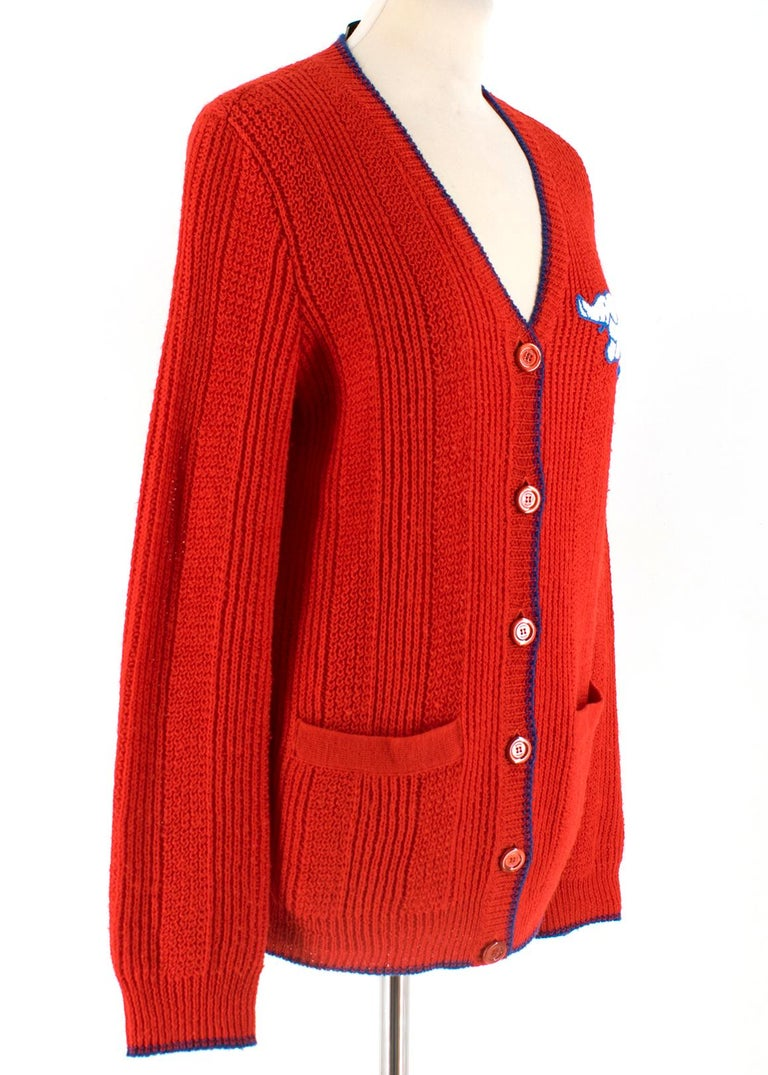 Gucci Women's Red Elephant Patch Cardigan. RRP £1200  -Long sleeve knit wool cardigan in bright red  - Rib knit blue Y-neck collar, cuffs, and hem - Embroidered elephant and logo in white and blue at the chest - Button closure at front - Patch
