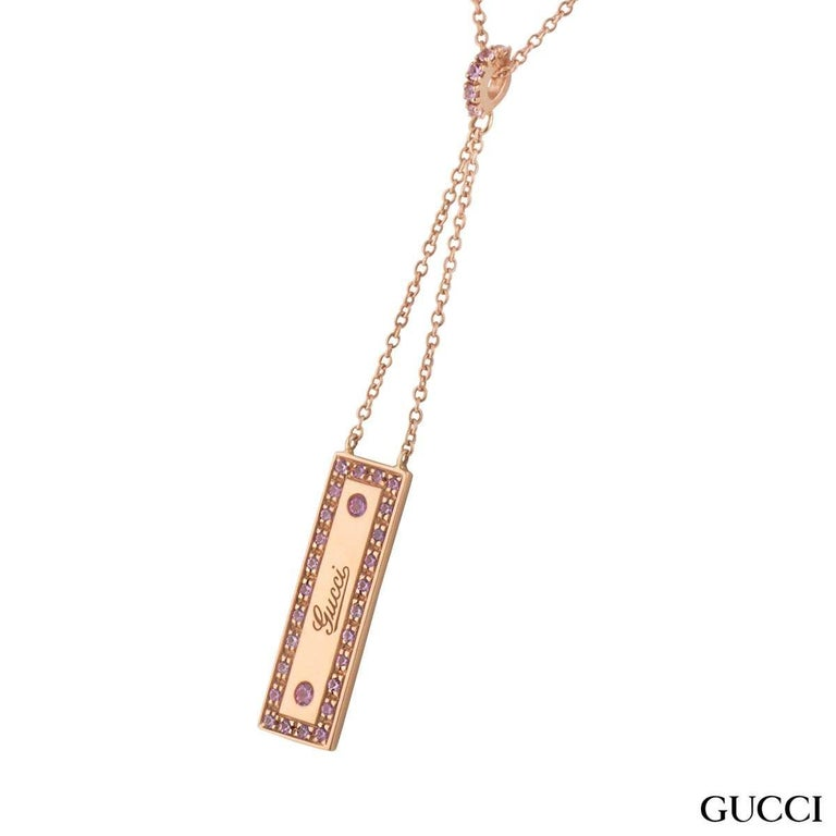 A beautiful 18k rose gold spinel Gucci pendant. The pendant comprises of a rectangle motif with 'Gucci' logo embossed in the centre. The logo has a box around set with pink spinel gemstones with a weight of approximately 0.25ct, with a pink hue