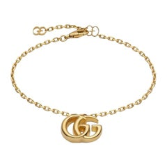 Gucci Running G 18 Karat Yellow Gold Bracelet with Double G Charm YBA501676001