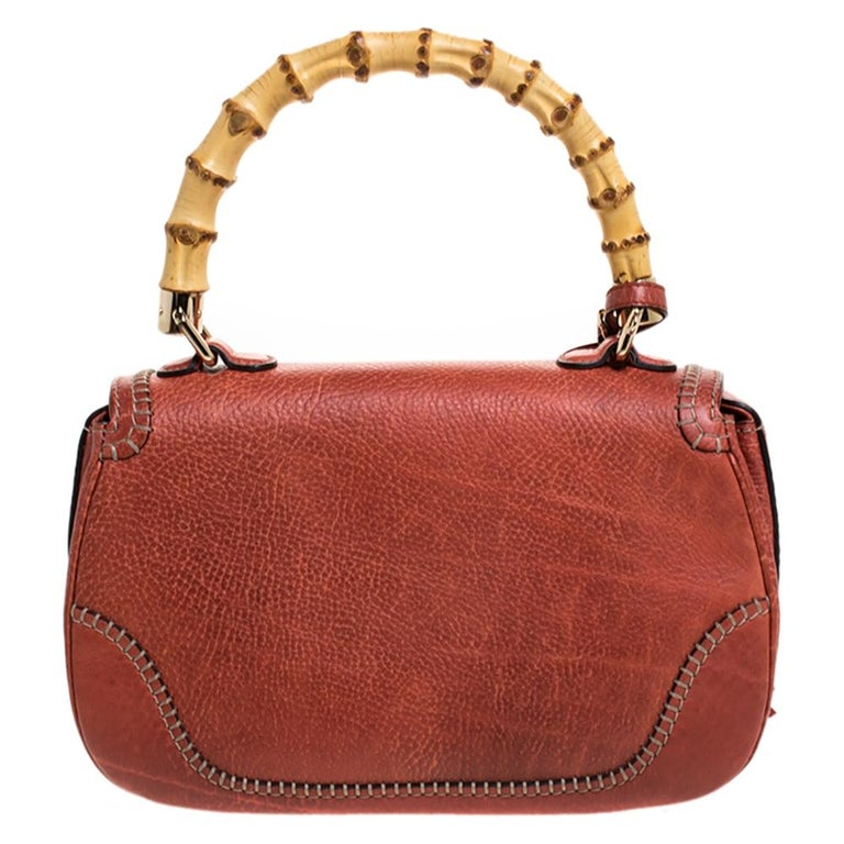 This Gucci bag combines style and elegance into the ultimate everyday bag. Crafted in Italy, it is made from quality leather and comes in a lovely shade. It is accented with a signature bamboo top handle. Secured with a bamboo turn-lock closure, the