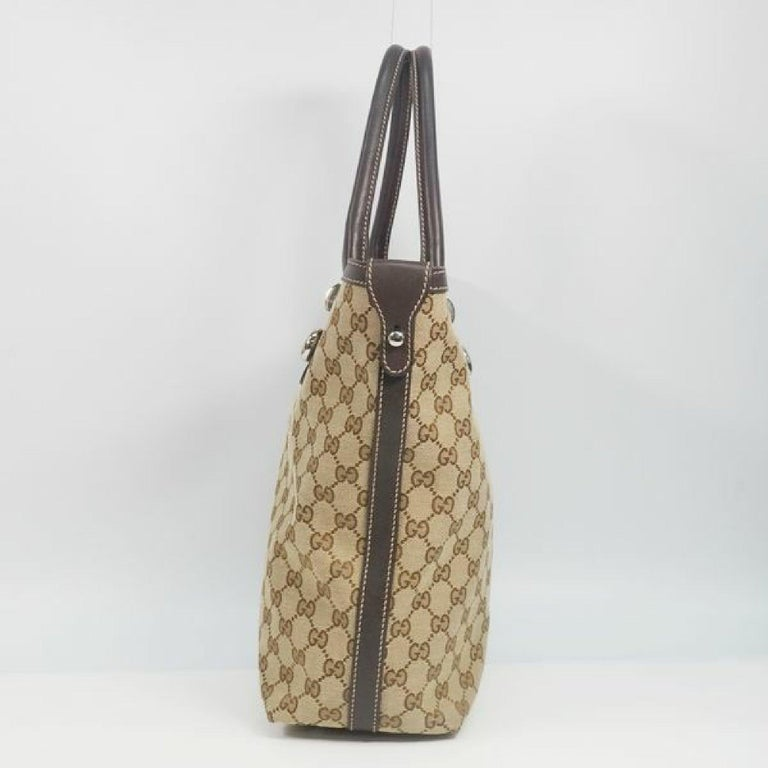 An authentic GUCCI Shelly Womens tote bag 232970 beige x brown. The color is beige x brown. The outside material is GG canvas/ leather. The pattern is Shelly. This item is Contemporary. The year of manufacture would be 1986. Rank AB signs of wear