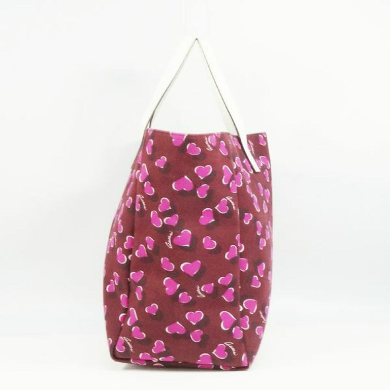 An authentic GUCCI shoulder tote heart Womens tote bag 282439 Bordeaux x white. The color is Bordeaux x white. The outside material is canvas/ leather. The pattern is shoulder tote  heart. This item is Contemporary. The year of manufacture would be