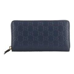 Gucci Signature Zip Around Wallet Guccissima Leather