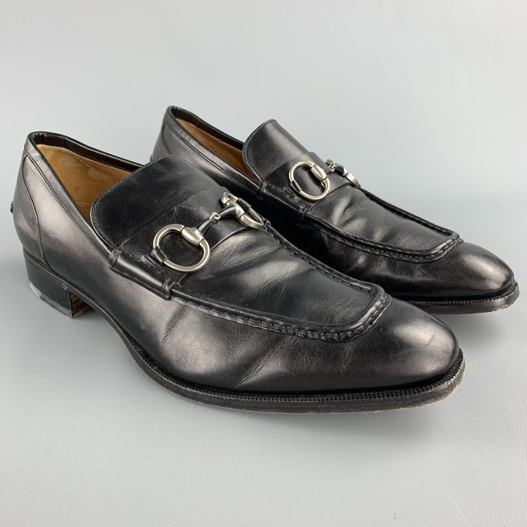 GUCCI loafers comes in a black leather featuring a horsebit and a wooden sole. Made in Italy.  Good Pre-Owned Condition. Marked: 225098 9.5   Outsole:   12 in. x 4 in.