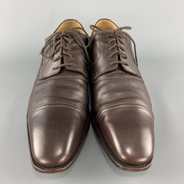 GUCCI dress shoes come in brown textured leather with a cap toe and lace up front. Wear throughout. As-is. With box. Made in Italy.  Good Pre-Owned Condition. Marked: UK 11  Outsole: 12.75 x 4.25 in.