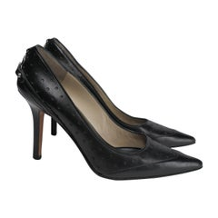 Gucci Size 6.5 Black Leather Perforated Pumps