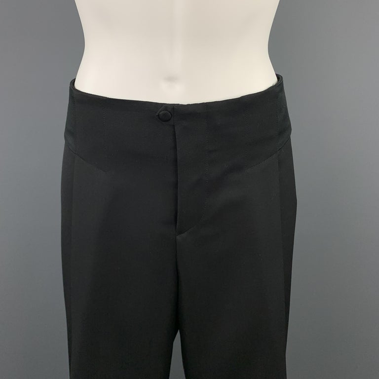 Archive GUCCI dress pants come in black wool with a single pleat wide leg, satin waistband side panels, and elastic closure at back. Elastic is a little stretched. As-is. Made in Italy.  Excellent Pre-Owned Condition. Marked: IT