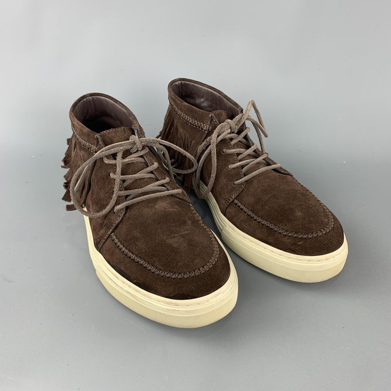 GUCCI sneaker comes in a brown suede featuring a lace up style, fringe detail, and a rubber sole. Made in Italy.   Very Good Pre-Owned Condition. Marked: 7   Measurements:   Outsole: 11.5 in. x 4.5 in.