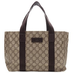 GUCCI Small GG Plus brown coated canvas monogram leather nylon handle tote bag