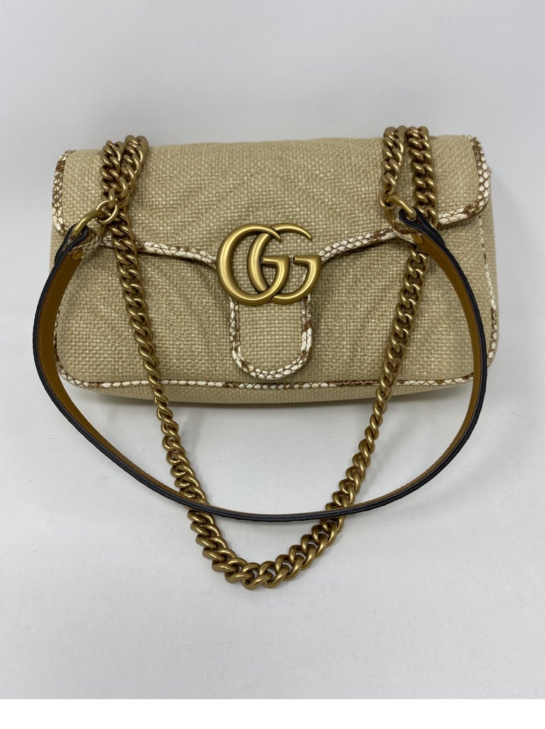 Gucci Small Marmont Straw Bag. Python style leather trim. Mint like new condition. Beautiful bag. Guaranteed  authentic. Dark tan leather interior and floral pattern material. Includes Gucci dust cover.