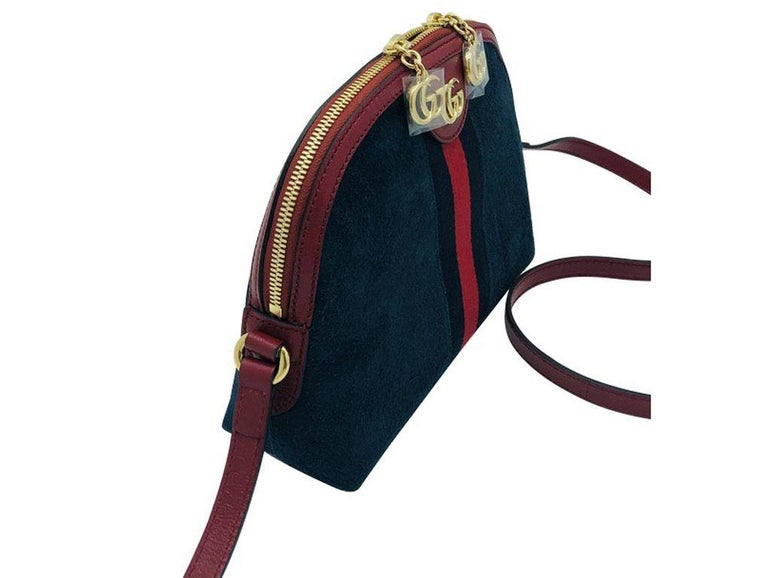 Gorgeous sleek Ophidia suede Shoulder bag by Gucci. Made from luxurious suede and patent leather with the iconic web detail. Purchased and stored so never used and in new condition.  BRAND Gucci  ACCESSORIES Care Card, Dust