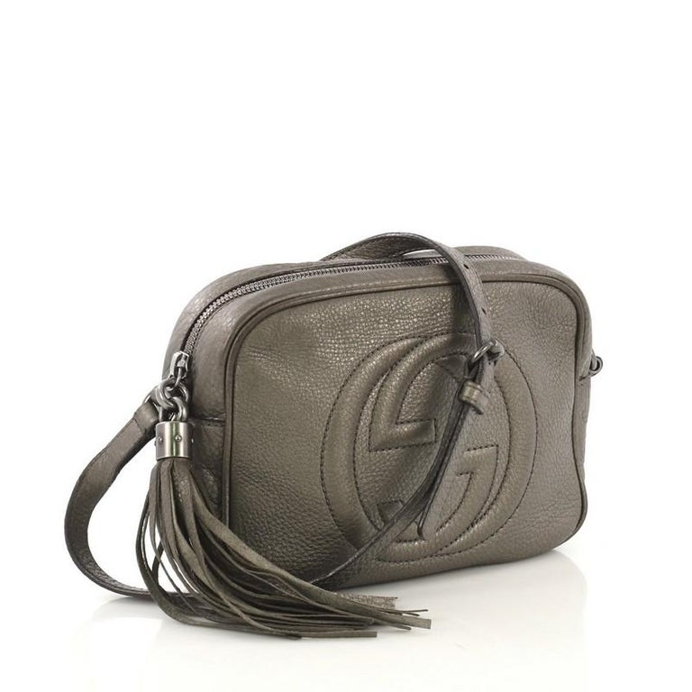 b6b138bdf This Gucci Soho Disco Crossbody Bag Leather Small, crafted in gray metallic  leather, features