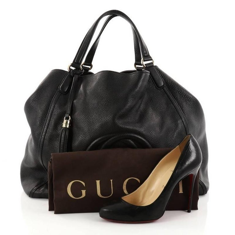 2ea26af639b This authentic Gucci Soho Shoulder Bag Leather Large is simple yet  luxurious in design. Crafted