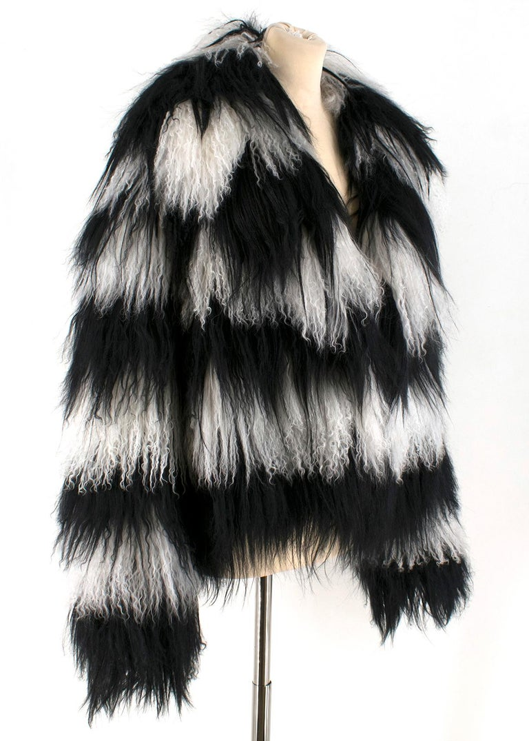 Gucci Striped shearling & goat hair jacket  - Concealed hook  - Handwoven from shearling and goat hair - Fastenings through front - Fabric1: 100% shearling (Lamb);  - Fabric2: 100% goat hair - Lining: 100% silk - Made in Italy  Please note, these
