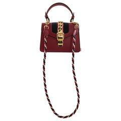 Gucci Sylvie red handle bag