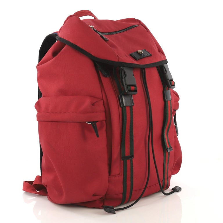 4afbba8b6 This Gucci Techpack Backpack Techno Canvas, crafted from red canvas,  features Web shoulder straps