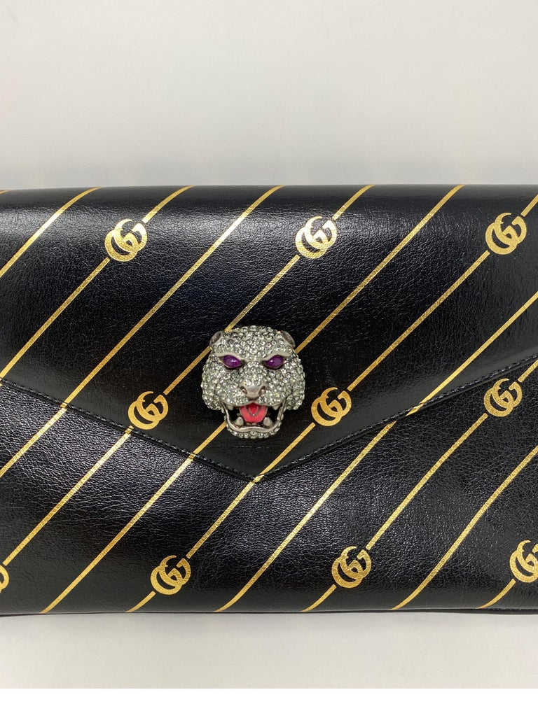 Gucci Thiara Broadway Envelope Clutch Bag. Crystal feline head with black leather embossed gold GG emblem. Beautiful bag by Gucci. Collector's piece. Mint like new condition. Guaranteed authentic.