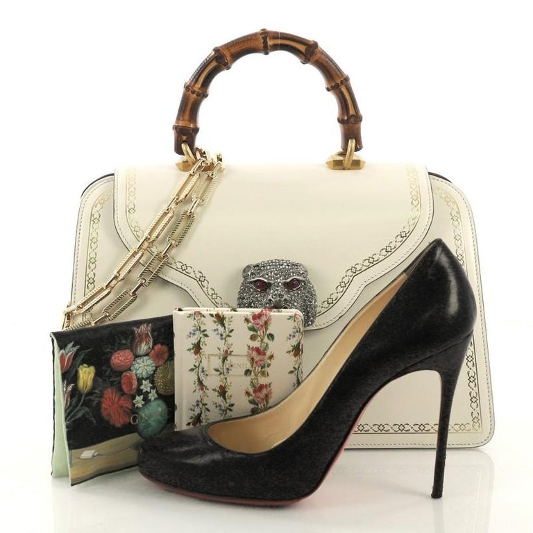 a25f0cc9f2309d This Gucci Thiara Top Handle Bag Frame Print Leather Medium, crafted from  off white leather