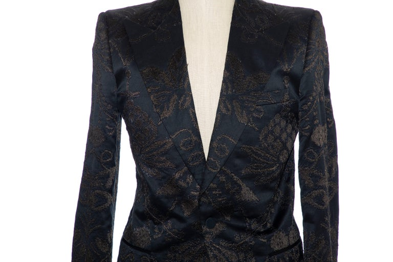 Tom Ford for Gucci black jacquard satin tuxedo blazer with peaked lapels, structured shoulders, three exterior pockets, embroidered jacquard pattern throughout, dual vents at rear, long sleeves, tonal satin lining, four interior pockets and