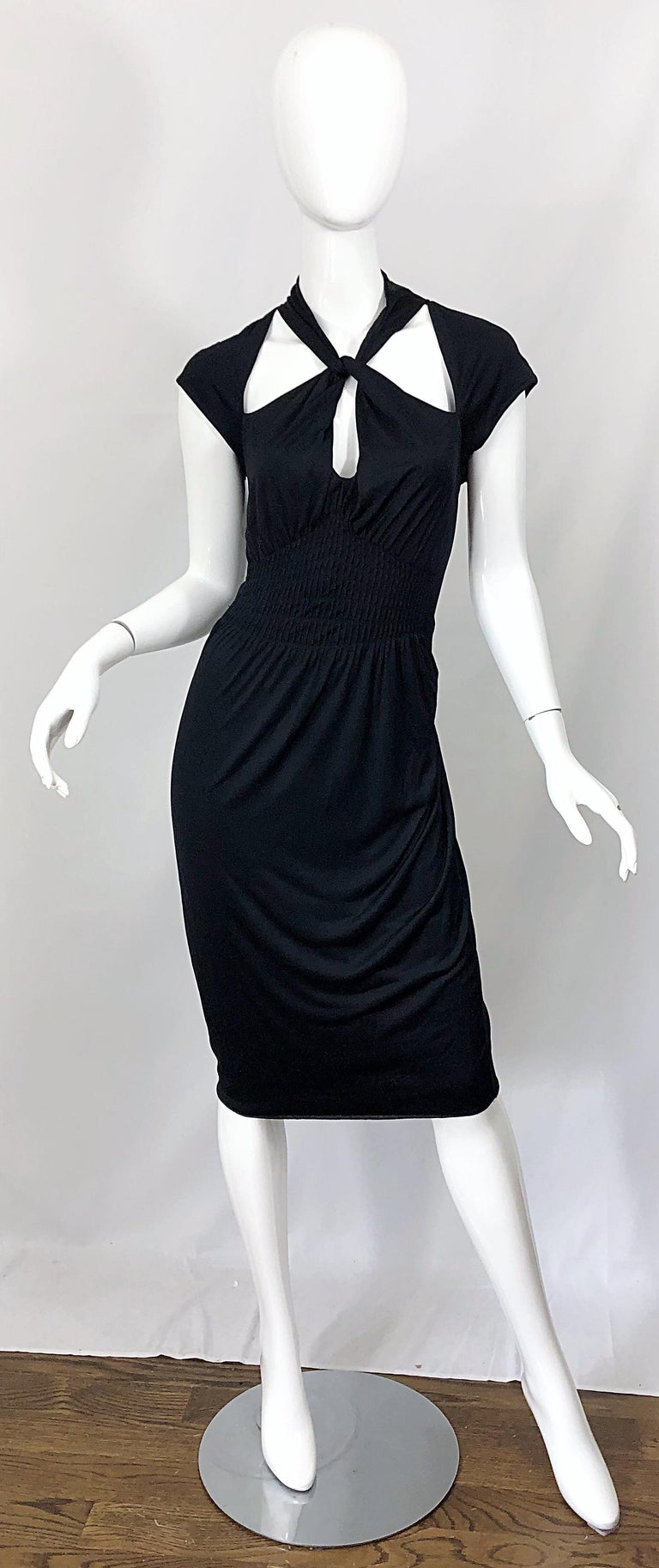 Sexy yet sophisticated GUCCI by TOM FORD Fall 2003 Runway dress! The long sleeve version was seen on Fergie and Naomi Watts for Red Carpet events. Cut-out detail at bodice gives the illusion of wearing a cap sleeve shrug. Halter style neck with a