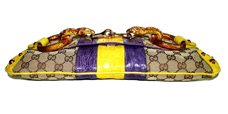 EXTREMELY RARE  GUCCI BY TOM FORD  GORGEOUS SNAKE HEAD JEWELLED GG MONOGRAM   LIMITED EDITION   DETAILS:  A GUCCI signature piece that will last you for many years From one of GUCCI's most stunning collections by Tom Ford Very rare Collector's