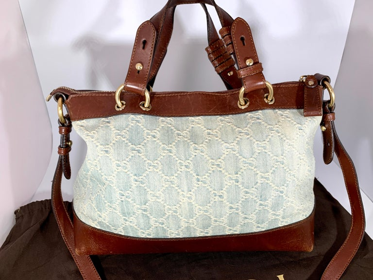 This is an authentic GUCCI Monogram  Original Tote bag . This chic bag  is crafted of blue Gucci Canvas . The Zippered  top  opens to a spacious natural fabric interior with one large Zippered  pocket and two slip pockets This is an excellent tote,