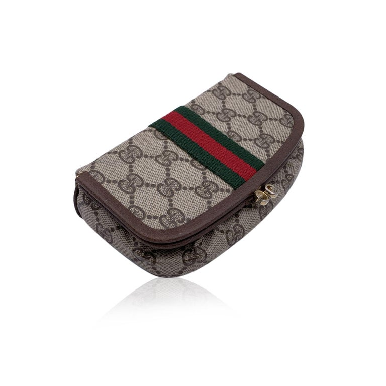 Gucci Vintage beige monogram canvas cosmetic case stripes. Beige Monogram Canvas with Genuine Leather trim. Green/Red/Green stripes around the bag. Buit-in mirror inside. Kiss lock closure. Brown lining.