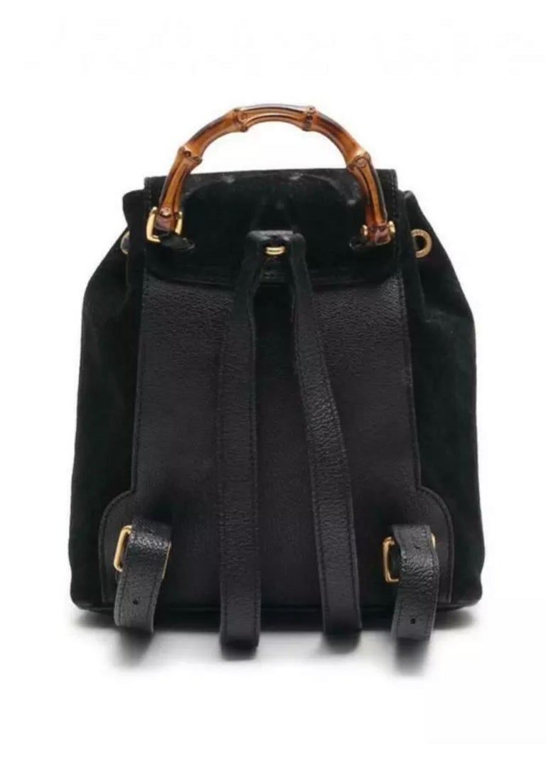 This backpack features a suede body, flat leather back straps, bamboo top handle, top flap with button closure, drawstring closure, exterior flap pocket with bamboo twist lock closure, and interior zip pocket.    Dimensions (cm) : 24 x 22 x 7