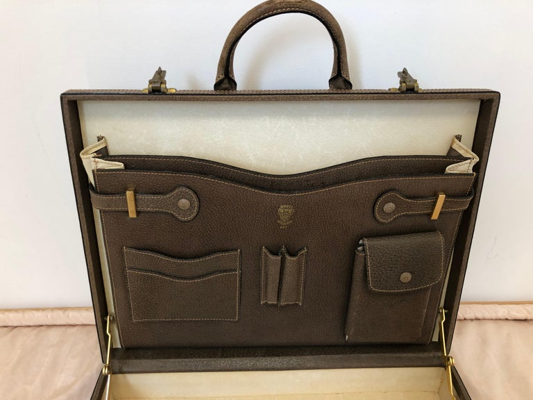 This Gucci briefcase is gorgeous in great vintage condition and practical as it will hold documents and a laptop.  It is a hard case, so will protect your equipment from harm. The briefcase comes with built-in compartments for pens, phone, cards,
