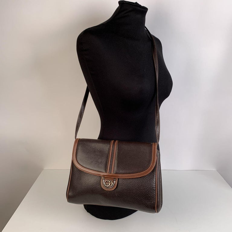 Gucci vintage brown leather crossbody bag. Can be used as a clutch purse if you remove its strap. Flap with magnetic button closure. GG - GUCCI logo on the front. Brown suede lining. 1 side zip pocket inside. Removable and adjustable shoulder strap.