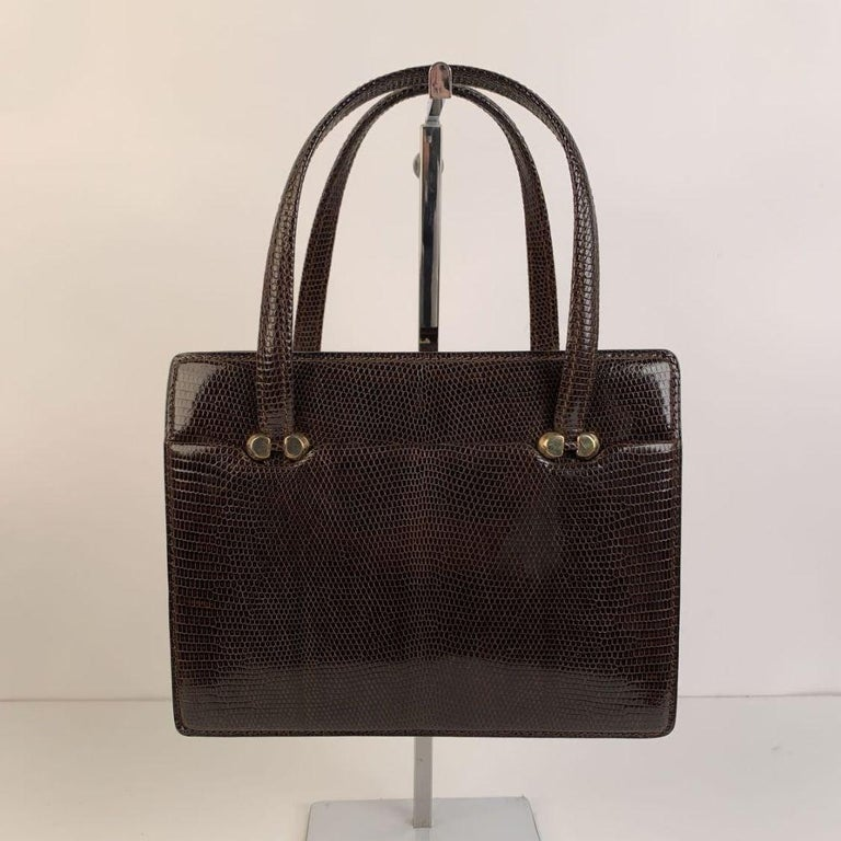 - Gucci Vintage Top Handle Bag - Brown Lizard Leather - Gold metal hardware - 1 flat open compartment on the front and 1 on the back - Clasp closure on top - Brown leather lining - 2 side open pockets and 1 side zip pocket inside - Removable