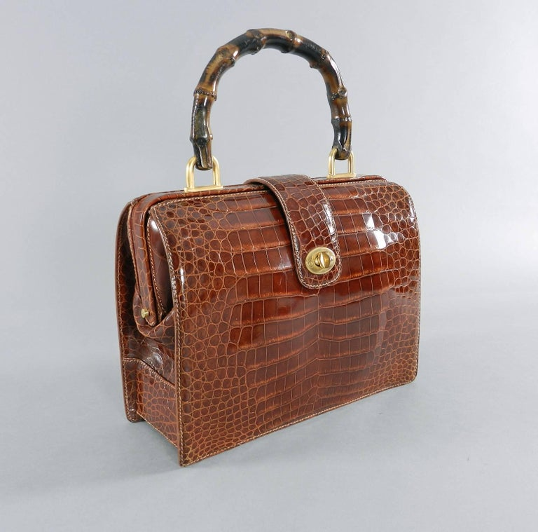 9d09a8b1b52c Gucci vintage cognac crocodile doctor bag with bamboo handle. Circa late  1990's. Suede lined