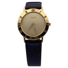 Gucci Vintage Gold Tone Stainless Steel 3000.2.M Watch Leather Strap