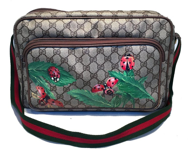 Gucci Vintage Monogram Customized Hand Painted Ladybug Reporter Messenger Shoulder Bag in very good condition. Gucci monogram canvas exterior trimmed with light brown leather, gold hardware, and signature green and red striped woven canvas shoulder