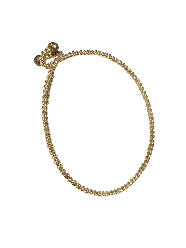 Circa 1970s Gucci 18K yellow Gold Bracelet in a Nautical Twisted Rope Design, 2 M.M. thick with an inside wrist measurement of 7 1/2 inches.