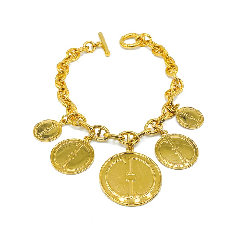 Gucci Vintage Charm Necklace  A rare and collectable statement piece from the Gucci 90s archive   Detail -Made in Italy in the early-mid 1990s -Crafted from gold plated metal -Chunky chain with signed toggle clasp -Five 70s inspired GG logo