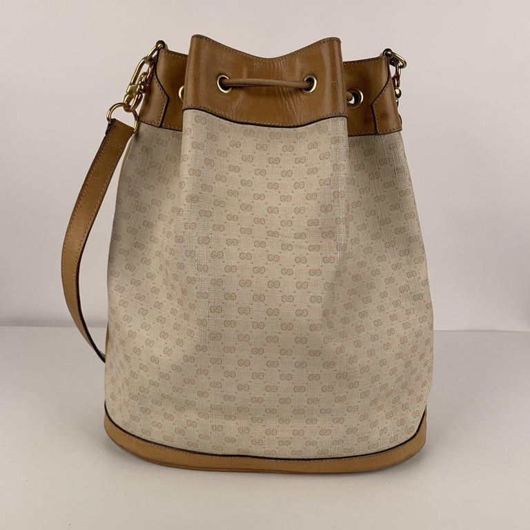 Brown Gucci Vintage White Monogram Canvas Drawstring Bucket Bag For Sale