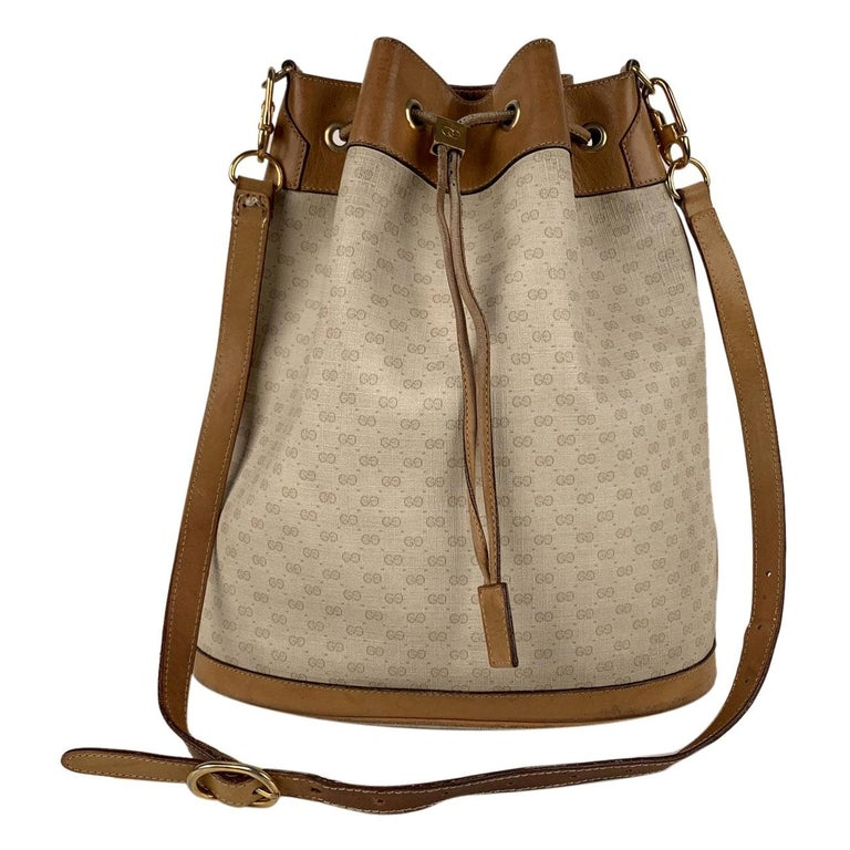 Gucci Vintage White Monogram Canvas Drawstring Bucket Bag For Sale