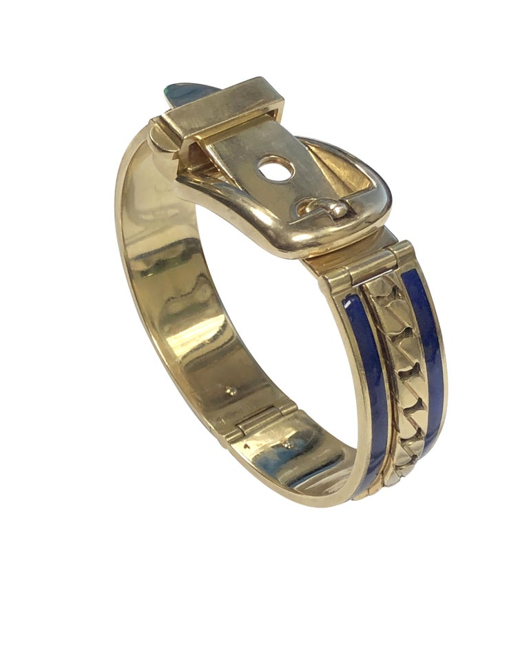 Circa 1970 Gucci Italy 18K Yellow Gold Buckle, Bangle Bracelet, measuring 9/16 inch wide and weighing 87.6 Grams. Having a center raise section of flat link chain with Cobalt Blue Enamel on either side. Wrist Size / Measurement 6 inches and is