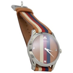 Gucci watch in brown, blue, red and white leather.