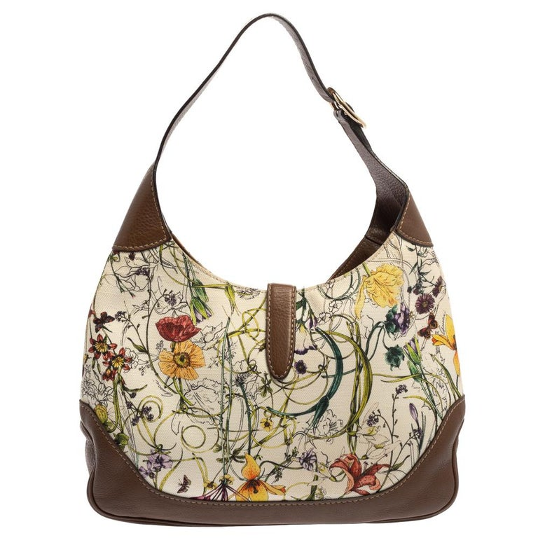 Gucci has always offered a line-up for cult accessories, just like this Jackie hobo originally designed in 1958 as a tribute to Jacqueline Kennedy Onassis. The canvas is printed with colorful blooms, while the contrasting leather edging gives it